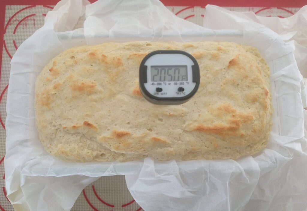 checking the temperature of keto bread
