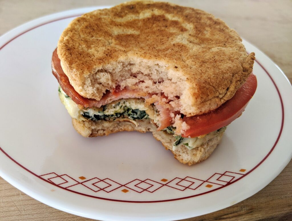 """Collagen English Muffin """"Egg McMuffin"""" with spinach egg whites, Canadian bacon and tomato"""